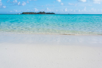 Tropical sand beach and blue sky with white clouds