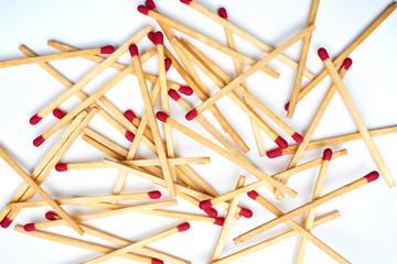 Matches lie against a matchbox, macro shot. Top View - flat lay.