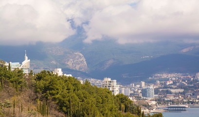 View of Yalta and Ai-Petri mountain with a cloud