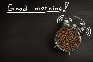 Retro alarm clock with coffee beans. Morning coffee after waking up. Wake up.