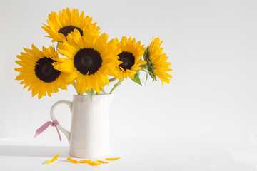 Yellow Sunflowers in a cream jug