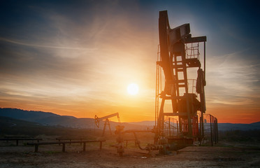 oil pump on sunset