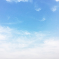 Soft white clouds against blue sky background and empty space for your design