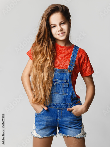 Cute Teen Girl Smiling Studio Portrait Of A Teenage Girl In Jeans And A T