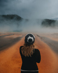Woman looking at Grand Prismatic Spring