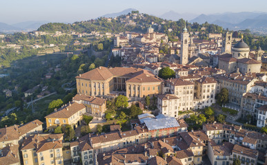 Drone aerial view of Bergamo - Old city (Città Alta). One of the beautiful city in Italy. Landscape on the city center and its historical buildings during a wonderful blu day