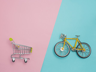 Collection of shopping cart  full of shopping time.Top view or flat lay composition cart on color background.
