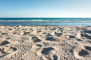 sea with blue sky and beach sand nature background.