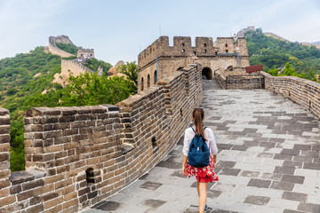 Wall Mural - Great Wall of china. Tourist on Asia travel walking on famous Chinese tourist destination and attraction in Badaling north of Beijing. Woman traveler hiking great wall enjoying her summer vacation.
