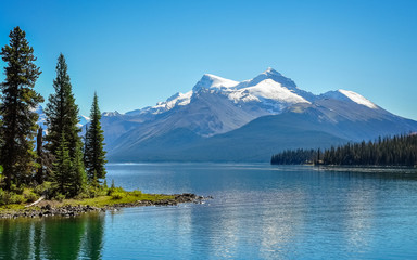 Maligne Lake -the largest glacial lake in the Canadian Rockies famous for the beautiful blue color of its water.