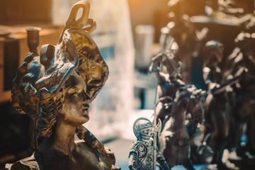 old metal figurines in sunday flea market. Antique bazaar