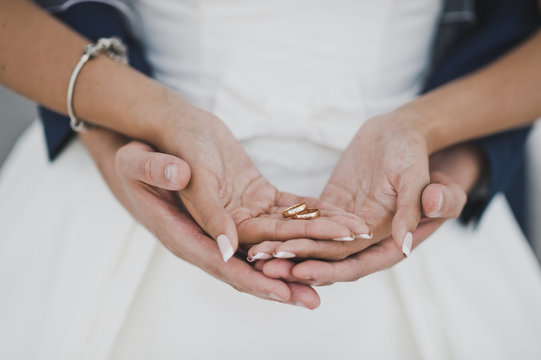 Arms of hands of Bridal couple with wedding rings 7701.