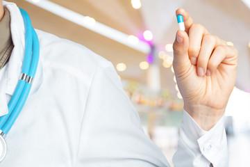 Doctor holding pills