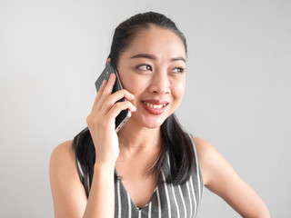 Smile and joyful woman talking on smartphone.