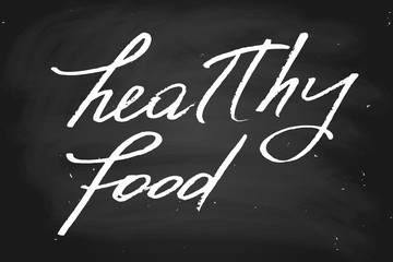 Healthy food. Handwritten text, chalk on a blackboard, vector. Each word is on a separate layer