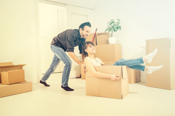 Young people move into a new apartment.