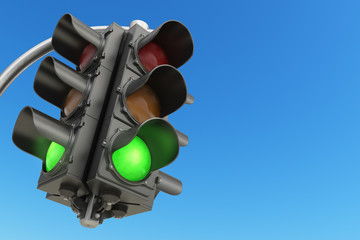 Traffic light with green color on blue sky background. Fotomurales