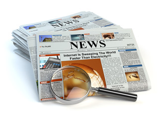 News concept. Newspapers and magnifying glass isolated on white.