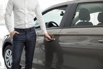 Young Man in a Car Rental Service Test Drive Concept