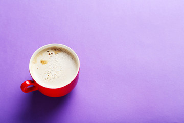 Cup of coffee on a purple background