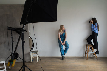 Girl photographer photographing model