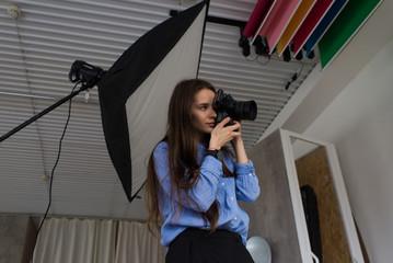 Girl photographer in studio