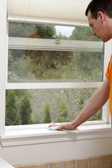 Cleaning a Window Sill with a Dust Cloth