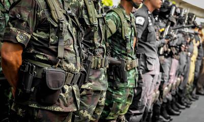 Thai soldiers with gun.