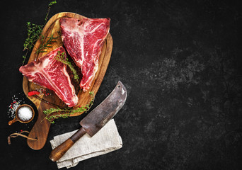 Raw dry aged t-bone steaks for grill