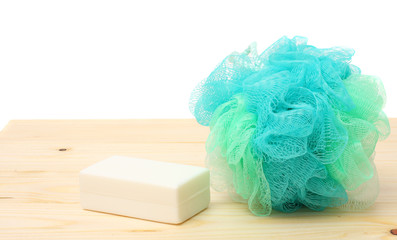 soap with wisp of bast on wood background