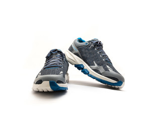 Close-up, top view running shoes for men isolated on white background. New unbranded running shoes, sneaker or training with clipping path and copy space. Active and healthy lifestyle.