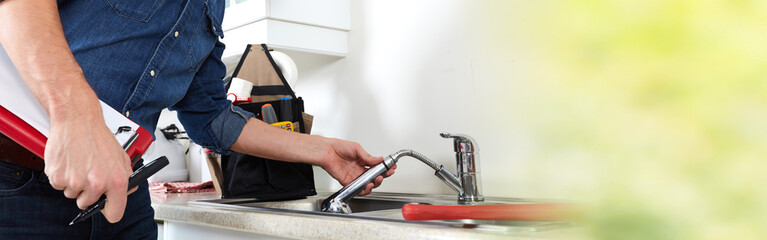Plumber hands and water tap