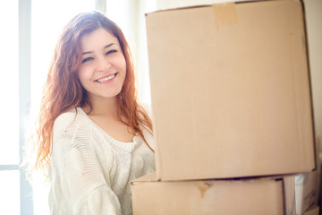 Smiling Redhead Woman House Moving with Boxes