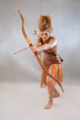 Woman in orange and brown outfit, warrior, fashion, studio