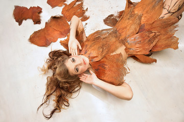 Woman in an orange fancy outfit, fashion, studio