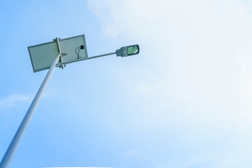 Solar powered Lamp post on blue cloudy sky , copy space for text.
