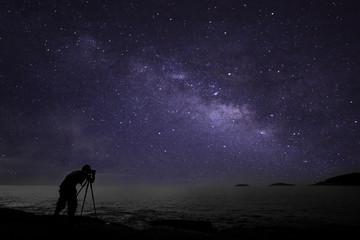 Obraz Photographer doing photography nightscape with milky way galaxy. - fototapety do salonu