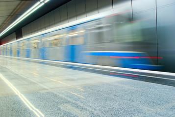 Moving subway train at metro station
