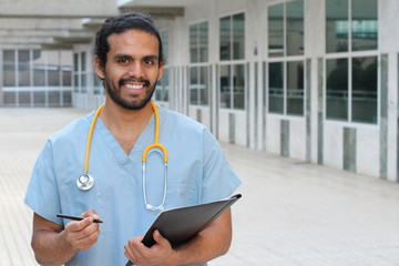 Ethnic doctor man posing happy with copy space - Stock image