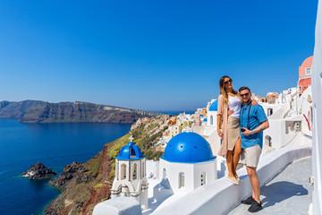 Young couple walking on Santorini