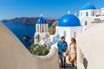 Young couple walking on Santorini