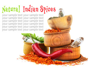Composition of different spices in wooden bowls on light background