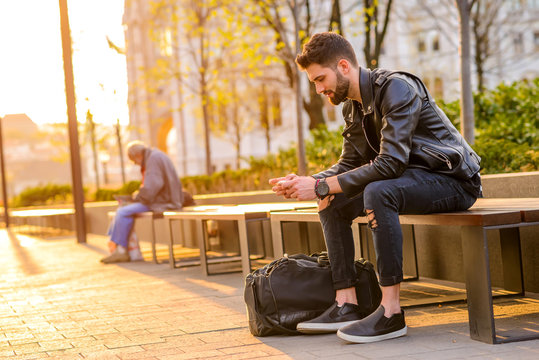 Young man sitting on a bench