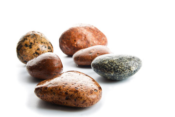 wet sea stones isolated on white background