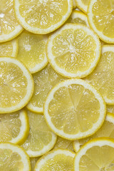 Background citrus ripe juicy slices of orange lemon shot close-up