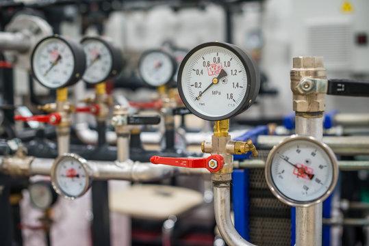 Closeup of a pressure meter on a machine, Pressure sensors in a large boiler room