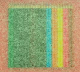 many colored pencils on a pink background
