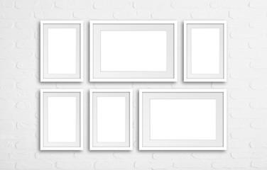 Six white frames set mock up on bricks wall background