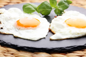 fried eggs with basil pepper and salt