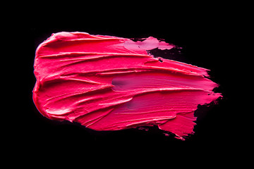 Smudged lipstick pink on a black isolated background